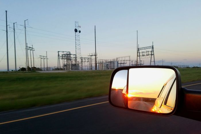 Business Finance And Industry Sunset Electricity  Electricity Pylon Car Road Transportation Cable Fuel And Power Generation No People Sky Day Outdoors City Nature