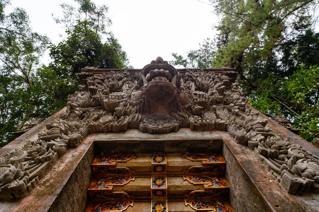 Gate guardian in Tirta Empul tempel of Bali Architecture Bali Bali, Indonesia Day Gate Guardian INDONESIA Low Angle View No People Outdoors Sculpture Sky Statue Tampaksiring Tirta Empul Tirta Empul Temple Travel Travel Destinations