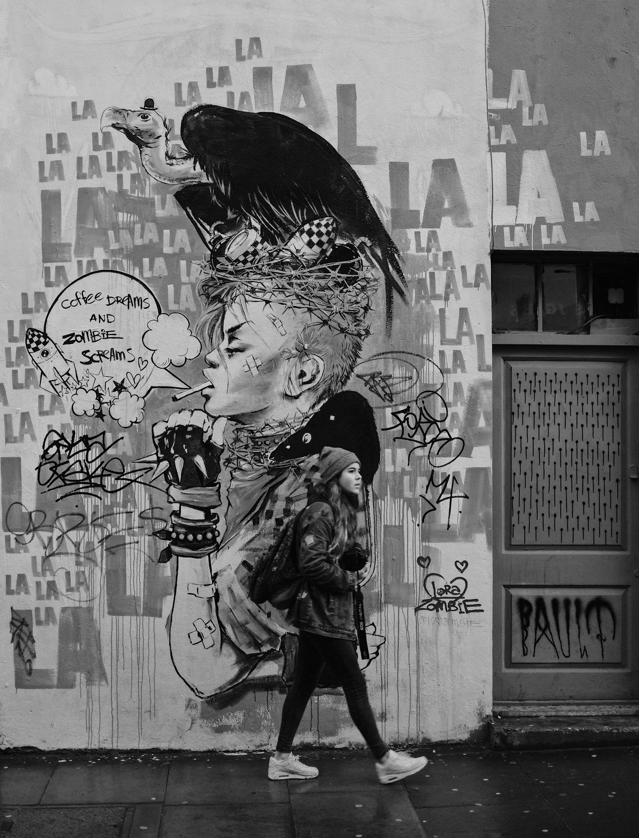 Full Length Lifestyles Woman Teenager Day One Person Outdoors Real People Architecture Graffiti Art ArtWork Street Street Photography Urban Funky Walking Walking Around Monochrome Black And White People EyeEm Best Shots EyeEm Gallery Check This Out Popular Photos