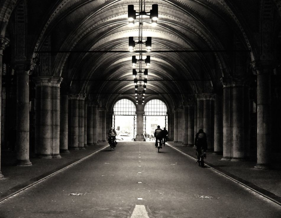 Amsterdam march 2016 Arch Architecture Built Structure Real People The Way Forward Bicycle Transportation Indoors  Architectural Column Men City People Photography Themes EyeEmBestPics Street Life EyeEm Best Shots Bw_collection Creativity Streetphotography_bw Tulip Amsterdam Citylife Netherlads Iamamsterdam Street Photography