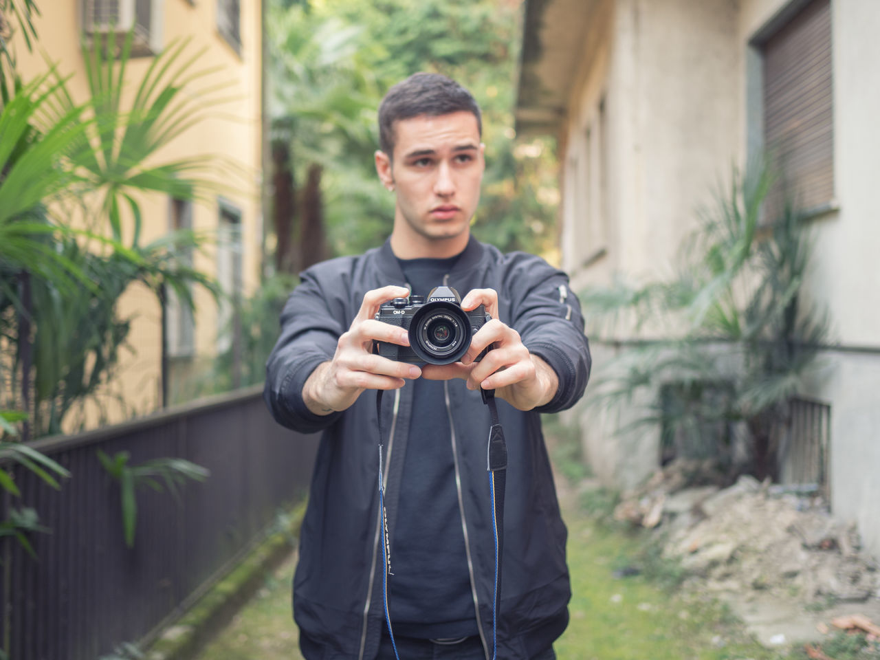 Camera Camera - Photographic Equipment Green Green Color Men Nature One Person Young Adult Young Men