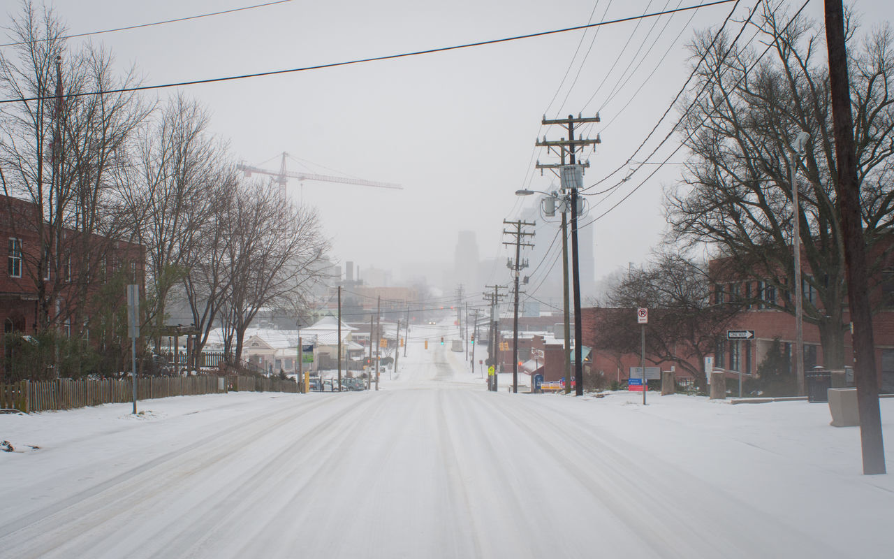 Blizzard City City Street Day Diminishing Perspective Downhill Durham Hill Icy Icy Road Jonas No People North Carolina Outdoors Road Snow Snow Covered Snowy Ground Snowy Road Southeast The Way Forward Vanishing Point Winter