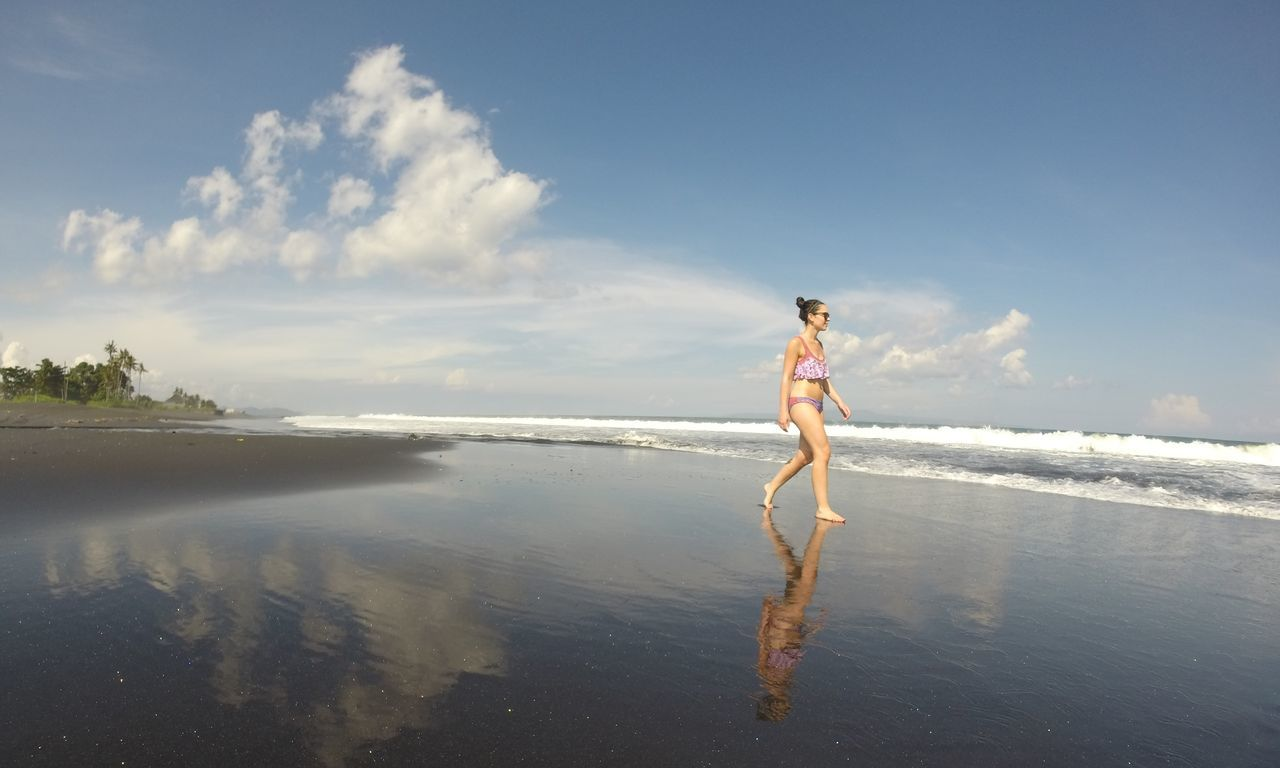 Bali Beach Beautiful Woman Beauty Black Sand Black Sand Beach Black Sand Reflection Healthy Lifestyle INDONESIA Keramas Beach Nature One Woman Only Outdoors Paradise Reflection Shore Sea Shore Summer Tropical The Great Outdoors - 2017 EyeEm Awards Live For The Story Lost In The Landscape Perspectives On Nature