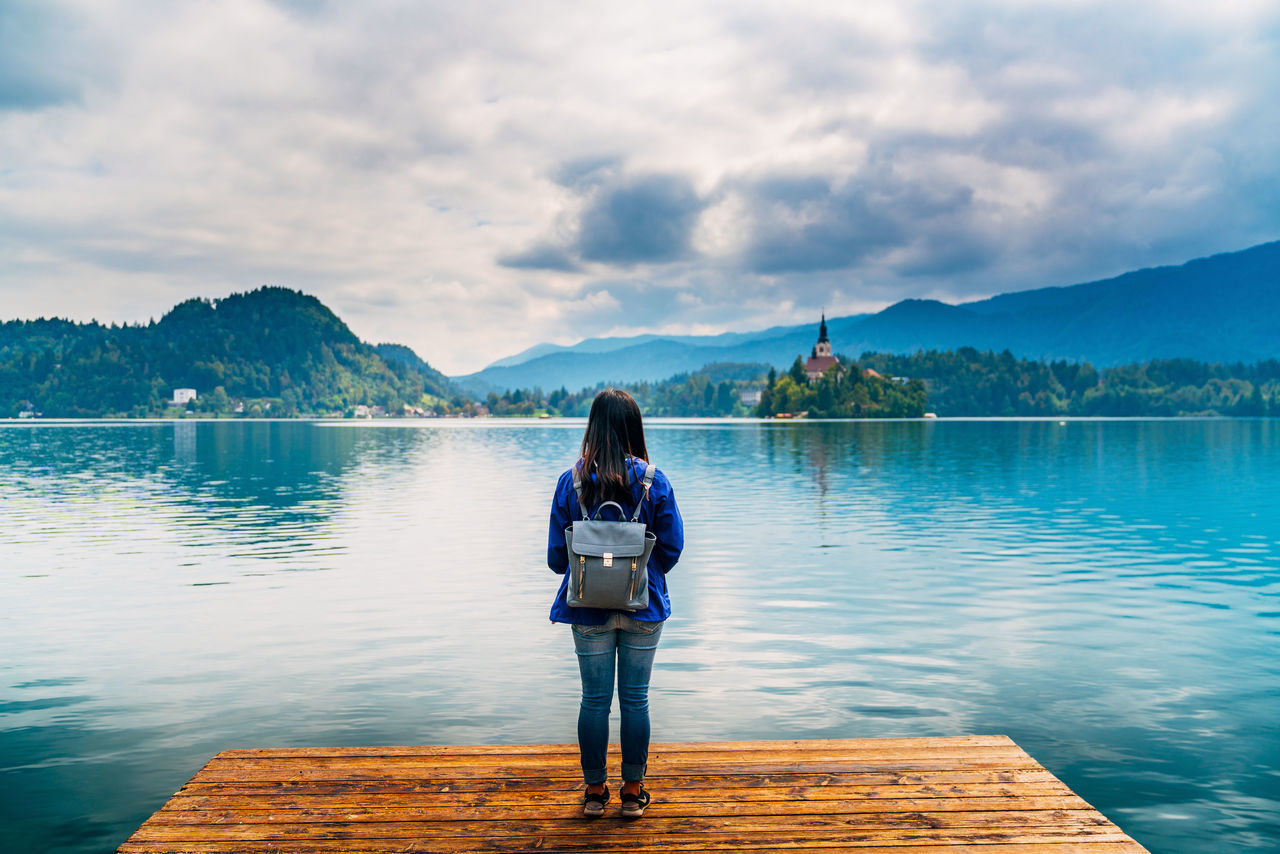 Adult Adults Only Beauty In Nature Casual Clothing Cloud - Sky Day Full Length Individuality Lake Mountain Nature One Person One Woman Only Only Women Outdoors People Pier Real People Rear View Reflection Scenics Sky Travel Destinations Vacations Water