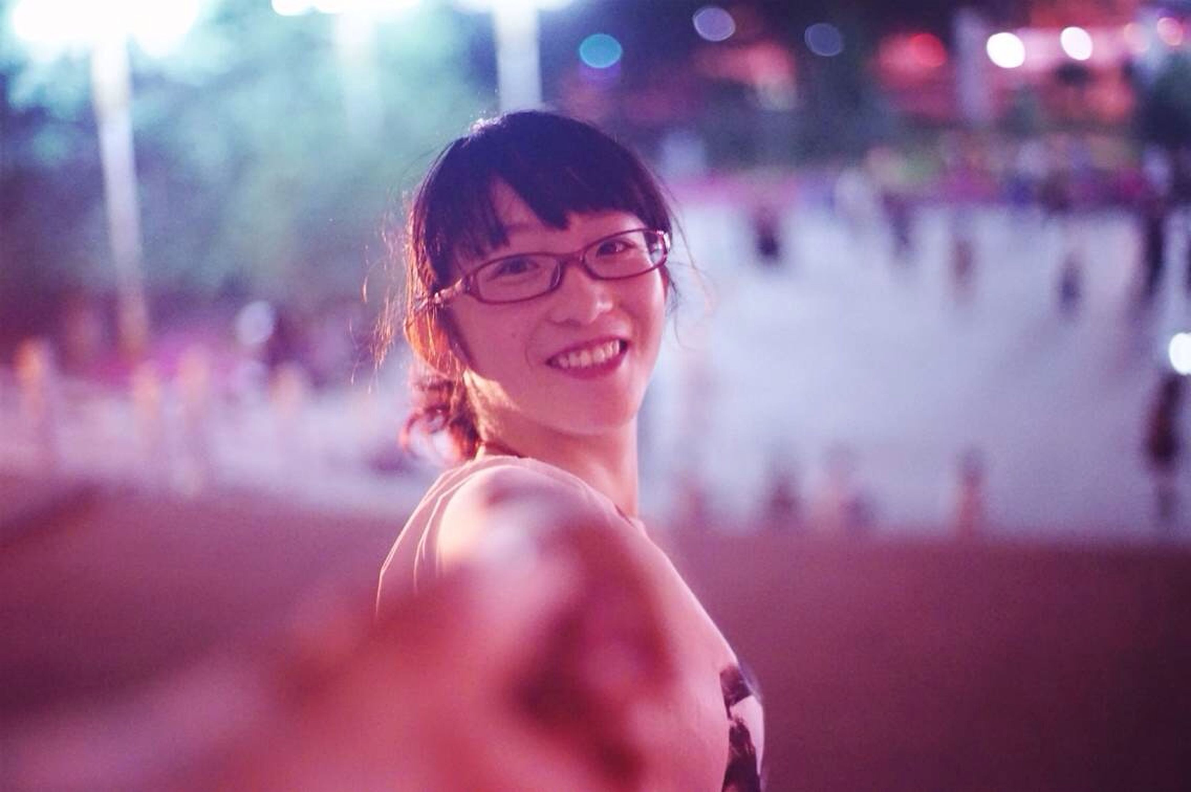 lifestyles, person, portrait, looking at camera, focus on foreground, leisure activity, front view, young adult, casual clothing, smiling, happiness, young women, standing, headshot, incidental people, waist up, elementary age