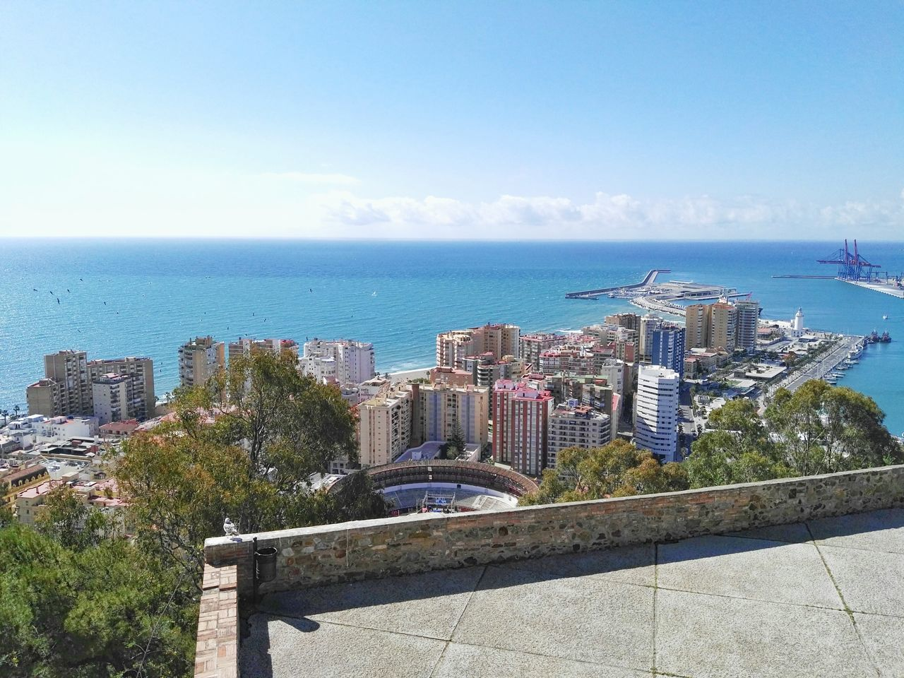 High Angle View Of Buildings Against Calm Blue Sea