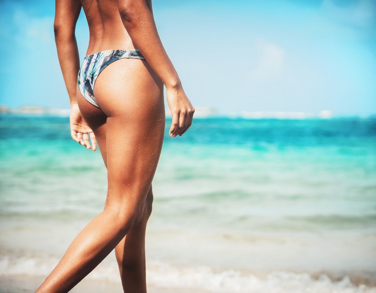 Beach Beauty In Nature Bikini Close-up Day Horizon Over Water Human Leg Leisure Activity Lifestyles Low Section Nature One Person Outdoors Real People Sea Sky Standing Water Young Adult Young Women