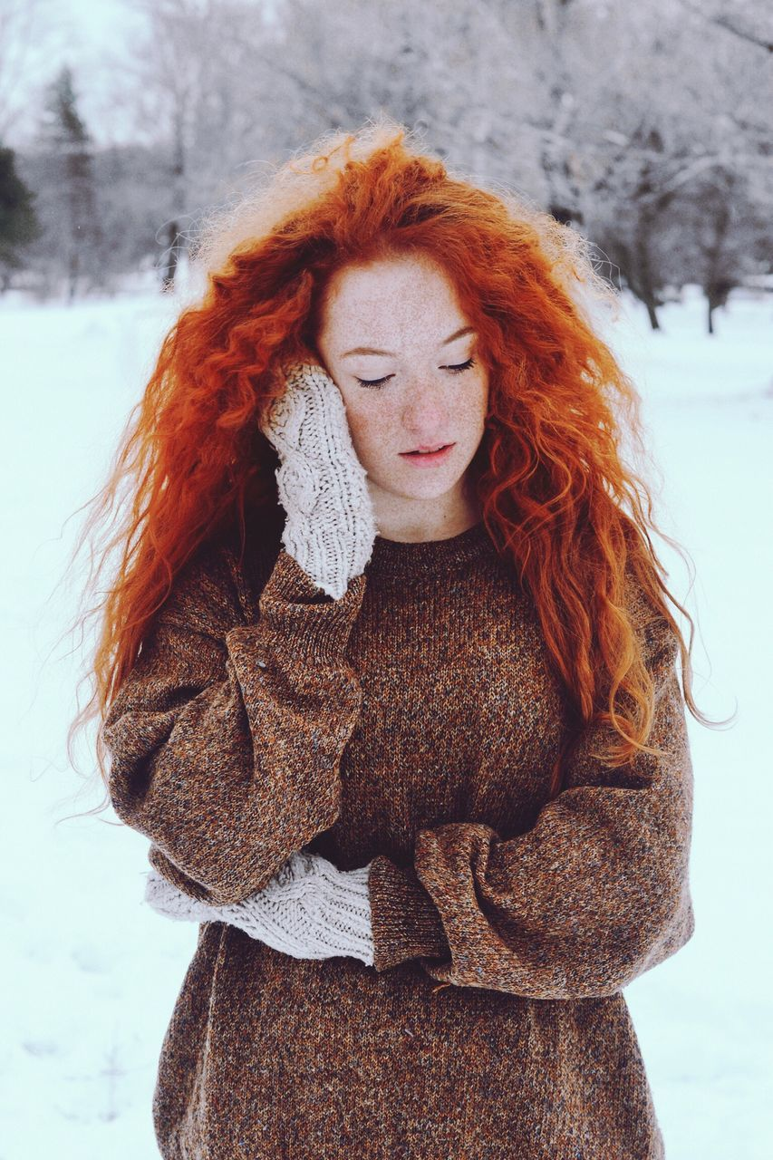 redhead, winter, cold temperature, snow, one person, long hair, outdoors, weather, warm clothing, scarf, young women, day, beautiful woman, red, young adult, real people, front view, portrait, standing, nature, beauty in nature, close-up, people