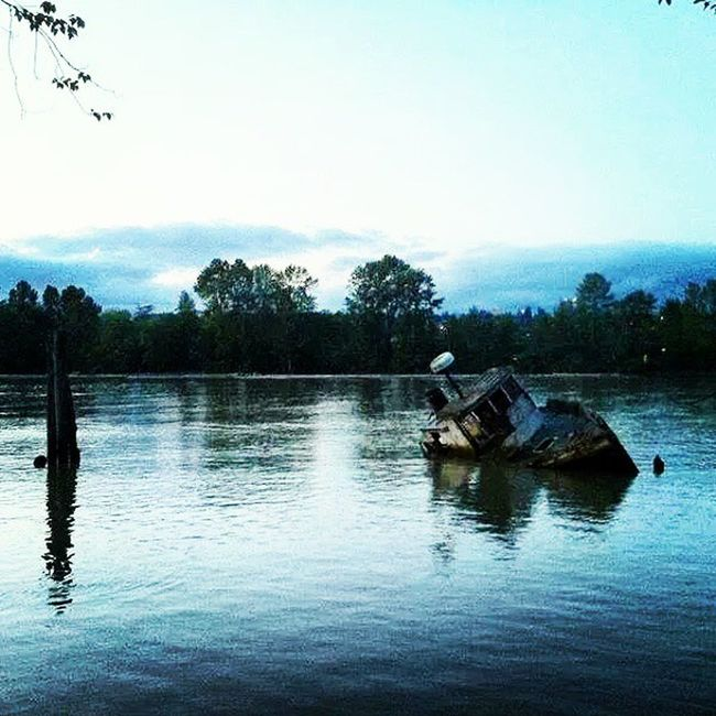 One of my favorite places to visit. River Road in Richmond BC Halfsunk Boat Fraserriver Chillspot relaxing view clearsky
