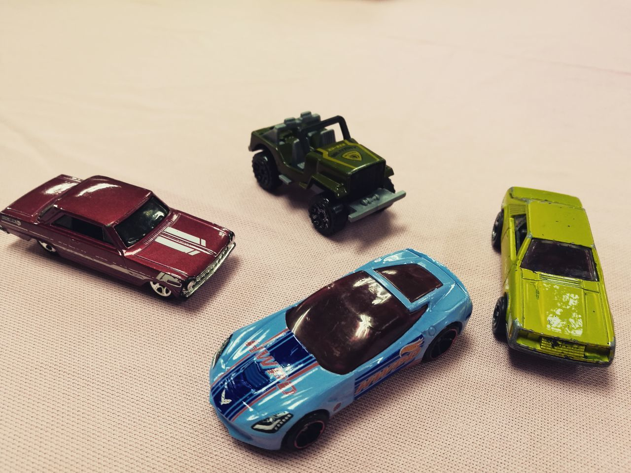 still life, toy car, toy, no people, high angle view, car, table, indoors, communication, technology, studio shot, wireless technology, white background, close-up, day
