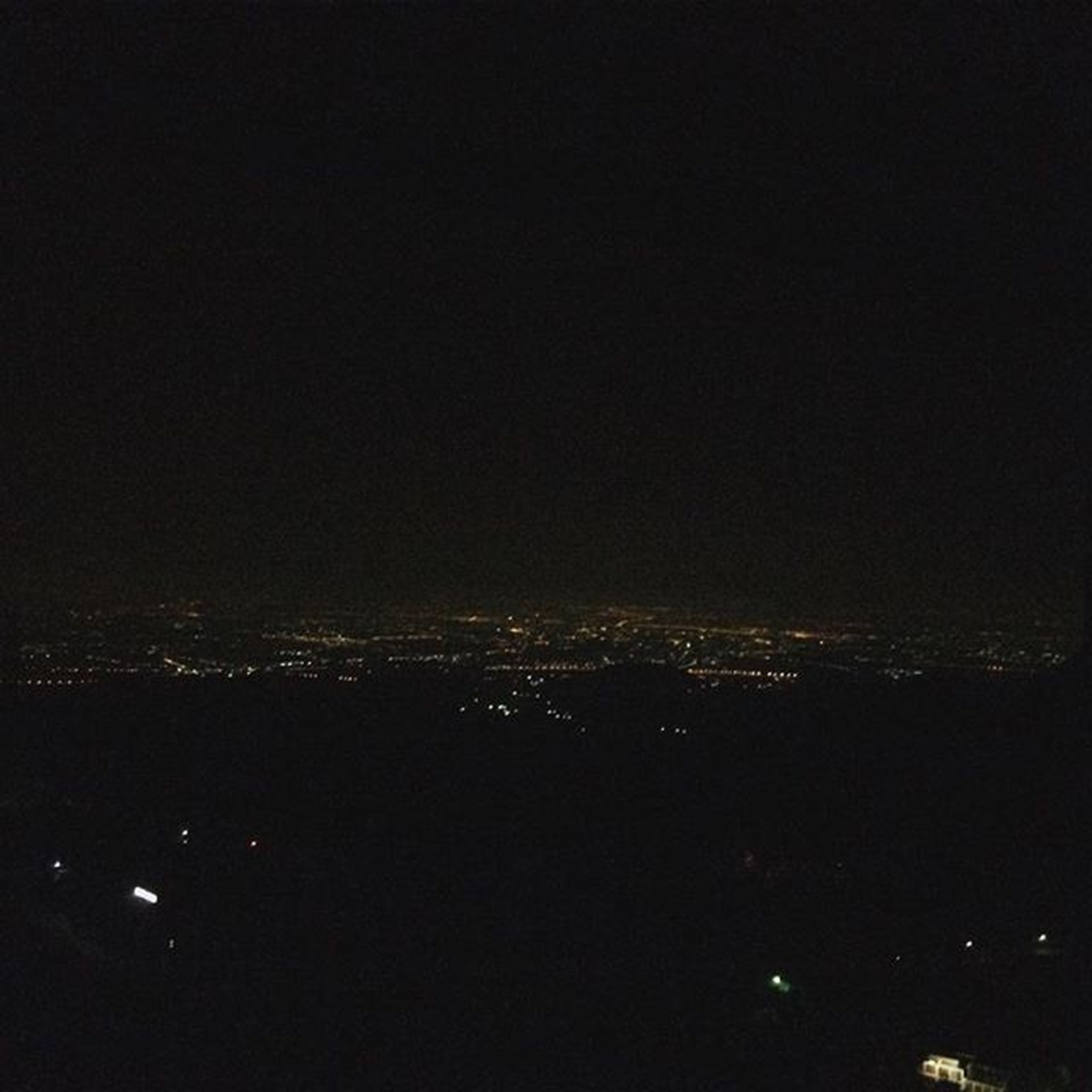 night, illuminated, cityscape, city, dark, copy space, building exterior, architecture, built structure, crowded, high angle view, clear sky, sky, aerial view, no people, outdoors, residential district, silhouette, city life, scenics