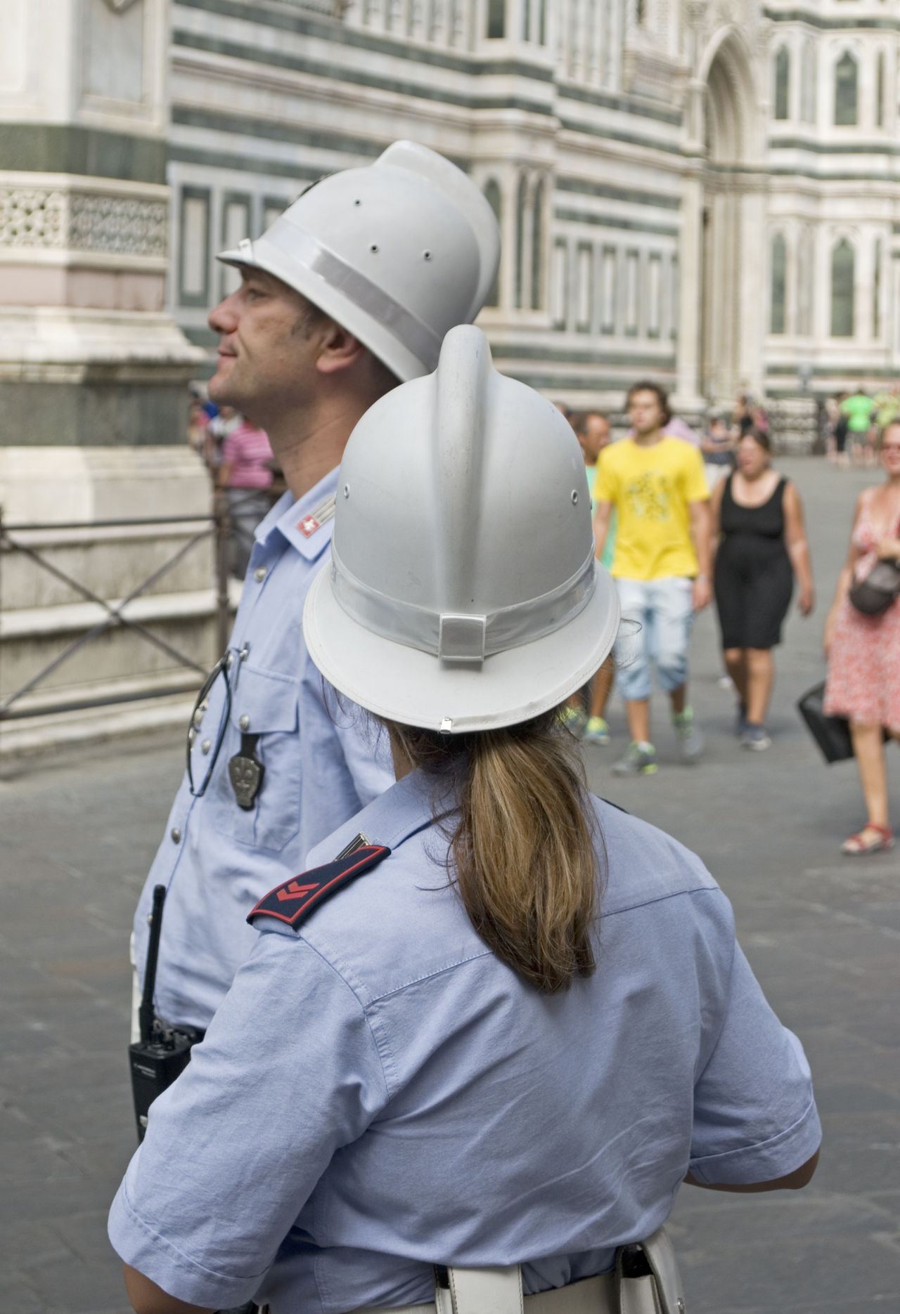 Traffic Police in Piazza Santa Croce, Florence, Italy City Couple Day Europe Florence Headwear Helmet Italian Italy Man Outdoors People Police Police Officers Policeman Real People Street Tourism Traffic Police  Travel Destinations Uniform Urban Woman