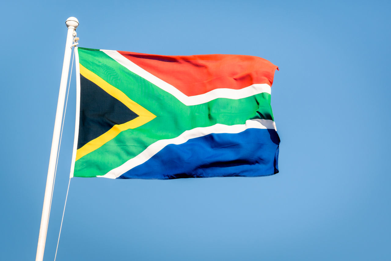 South african flag on a blue sky - Pride of the nation South Africa adopted on 27 April 1994 representing the new democracy Freedom National South Africa South African Photography Travel Clear Sky Concept Flag Flags Fluttering No People Outdoors Patriotism Pride Sky South African South African Flag Travel Destinations Waving Wind