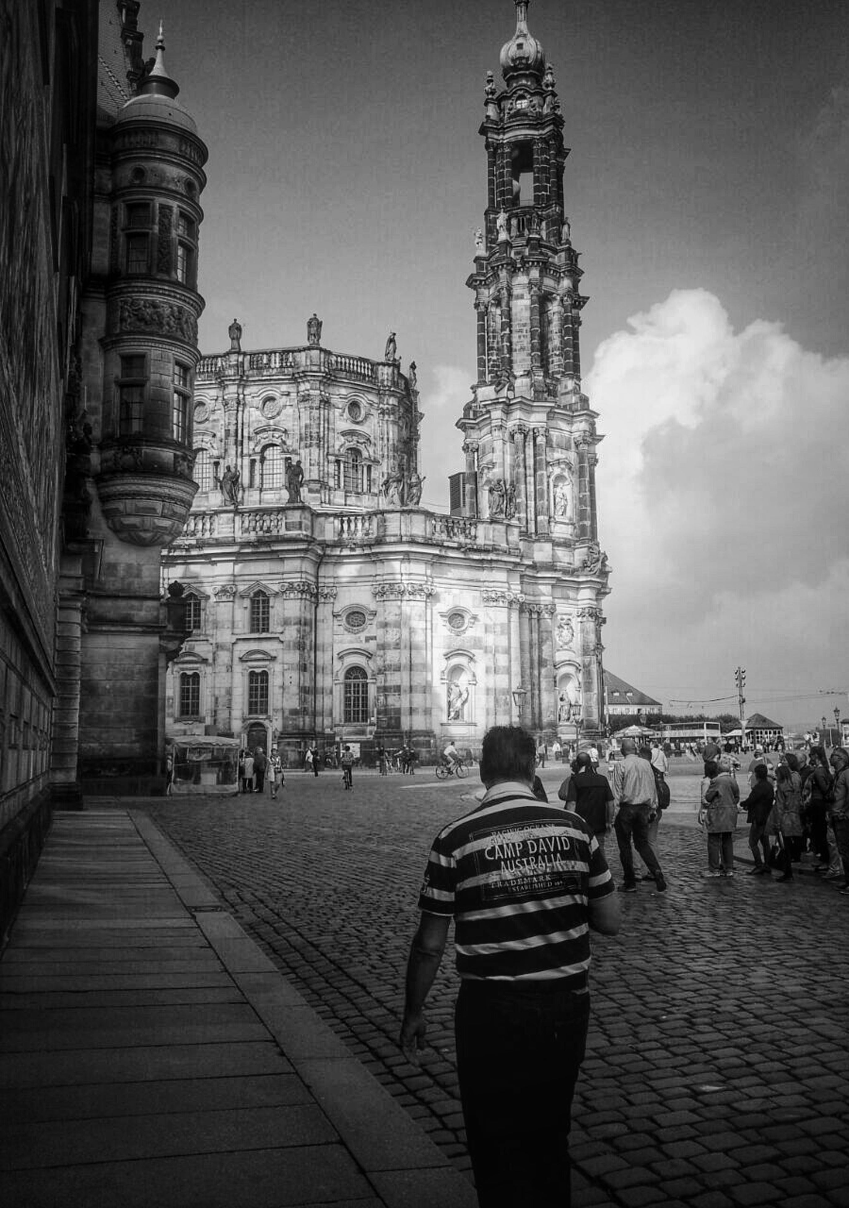 architecture, building exterior, built structure, men, street, walking, sky, lifestyles, person, the way forward, city, place of worship, cobblestone, travel destinations, famous place, religion, travel, history, incidental people