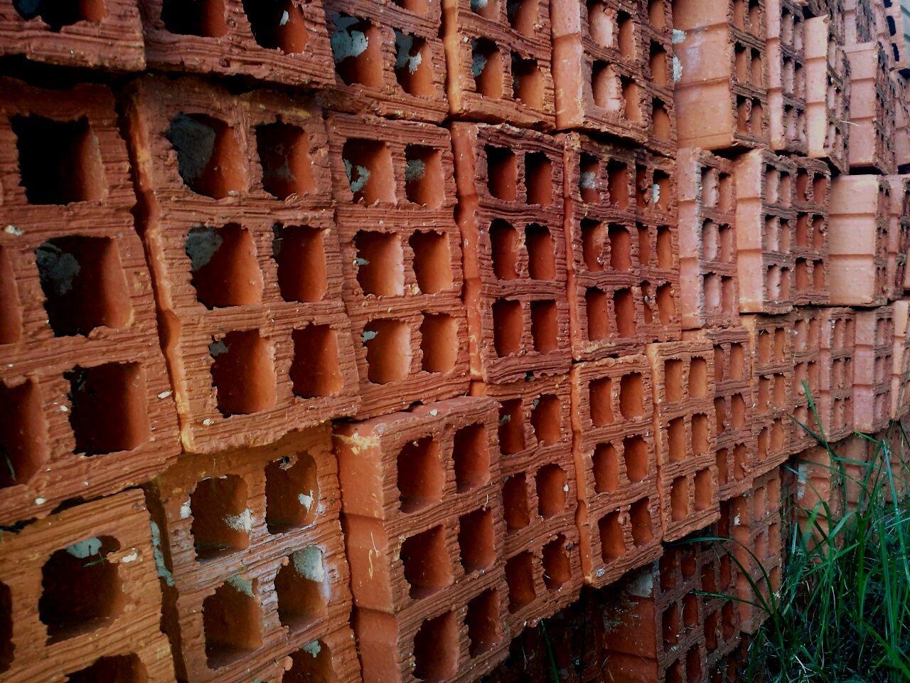 Stack Of Brick Blocks Arranged Outdoors