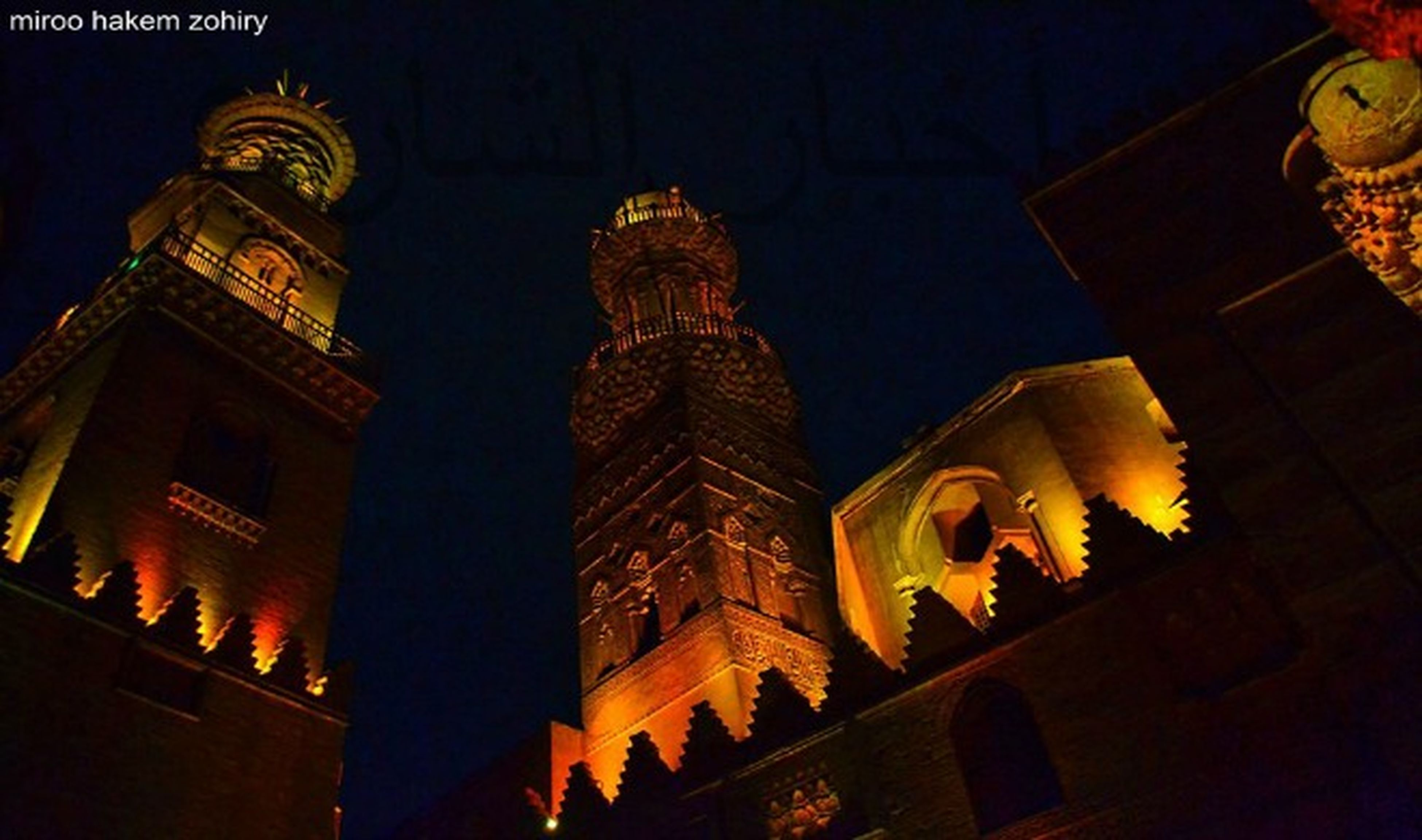 low angle view, architecture, building exterior, built structure, religion, place of worship, night, illuminated, spirituality, sky, famous place, history, travel destinations, church, outdoors, no people, city, capital cities
