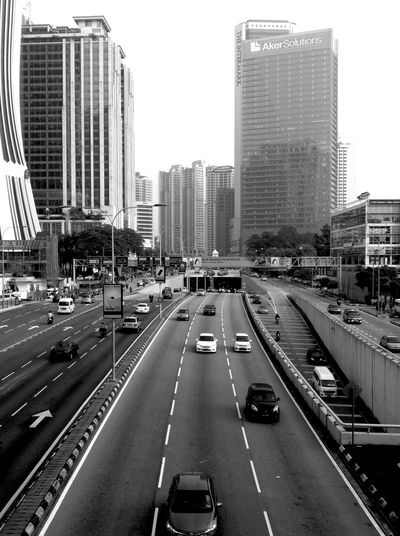 Learn & Shoot: Leading Lines 19-Oct-2015 Took this shot while waiting for the van that was ferrying our late beloved Coordinator who passed away due to a fatal sports bike accident two Sundays ago, to appear from the underpass on last Friday. Hence the black and white filter. You are dearly missed, Ernie. Ride in Heaven forever! Harley Davidson Owners Headhunters Black&white IPhoneography Iphone4 Found On The Roll