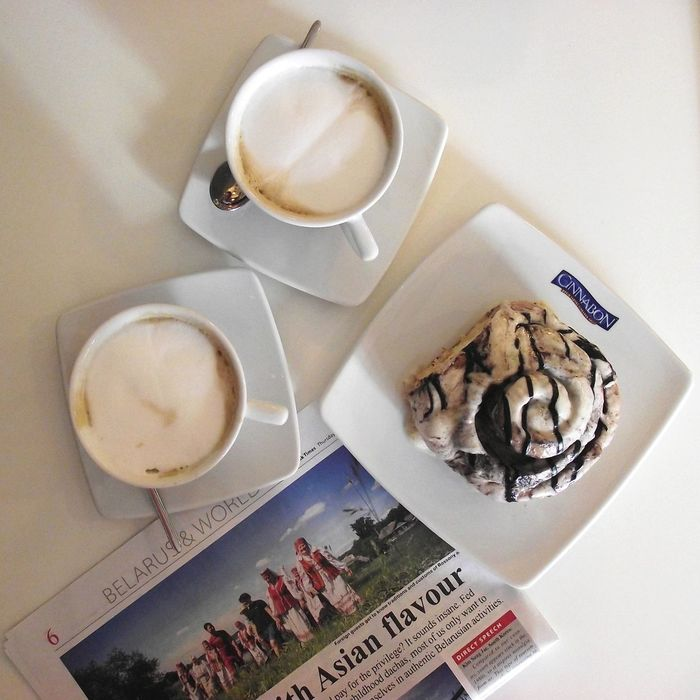 Article Backery Bowl Cappuccino Cinnabon Cinnamon Coffee Day Drink Food Food And Drink Freshness High Angle View Horizontal Indoors  Newspaper Ready-to-eat Refreshment Rolls Serving Size Sweet Table