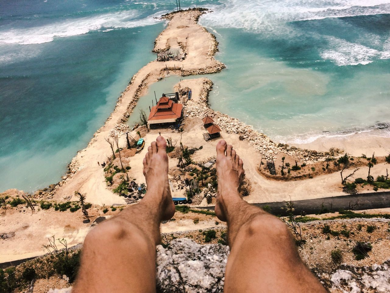 Arid Climate Balance Beach Carefree Cliff Enjoying The View Escapism Exploring Feet From Above  From My Point Of View Geology Legs Leisure Activity Lifestyles Men Outdoors Real People Relaxation Sand Sea Shore Summer Vacations Water