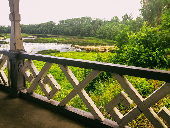 Venda river and falls seen from old wooden shelter, Kuldiga, Latvia Absence Day Fence Field Footpath Forest Grass Green Color Kuldiga Landscape Latvia Leading Park Railing River Safety Structure Summer Summertime The Way Forward Tree Tree Trunk Wood WoodLand