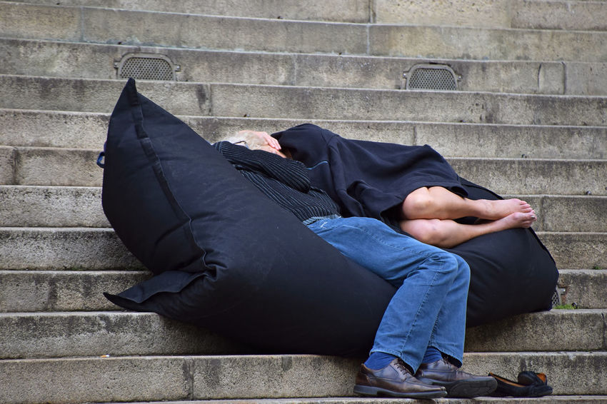 Man and woman relaxing, sleeping on bean bag chair in the street stairs Chair Man Pillow Romantic Stairs Steps Adult Bean Bag Black Black Color Day Lifestyles Men Outdoors People People And Places People Photography Real People Relaxation Relaxing Moments Relaxing Time Romantic Place Sleeping Stair Street