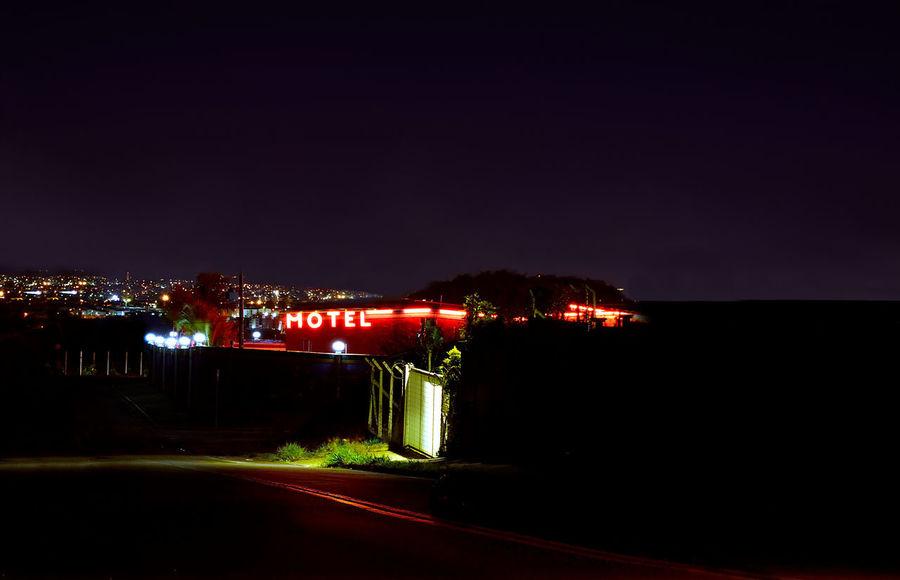 Building Exterior City Dramatic Forbidden Illuminated Long Exposure Motel Sign Neon Night No People Road Secret Places Street