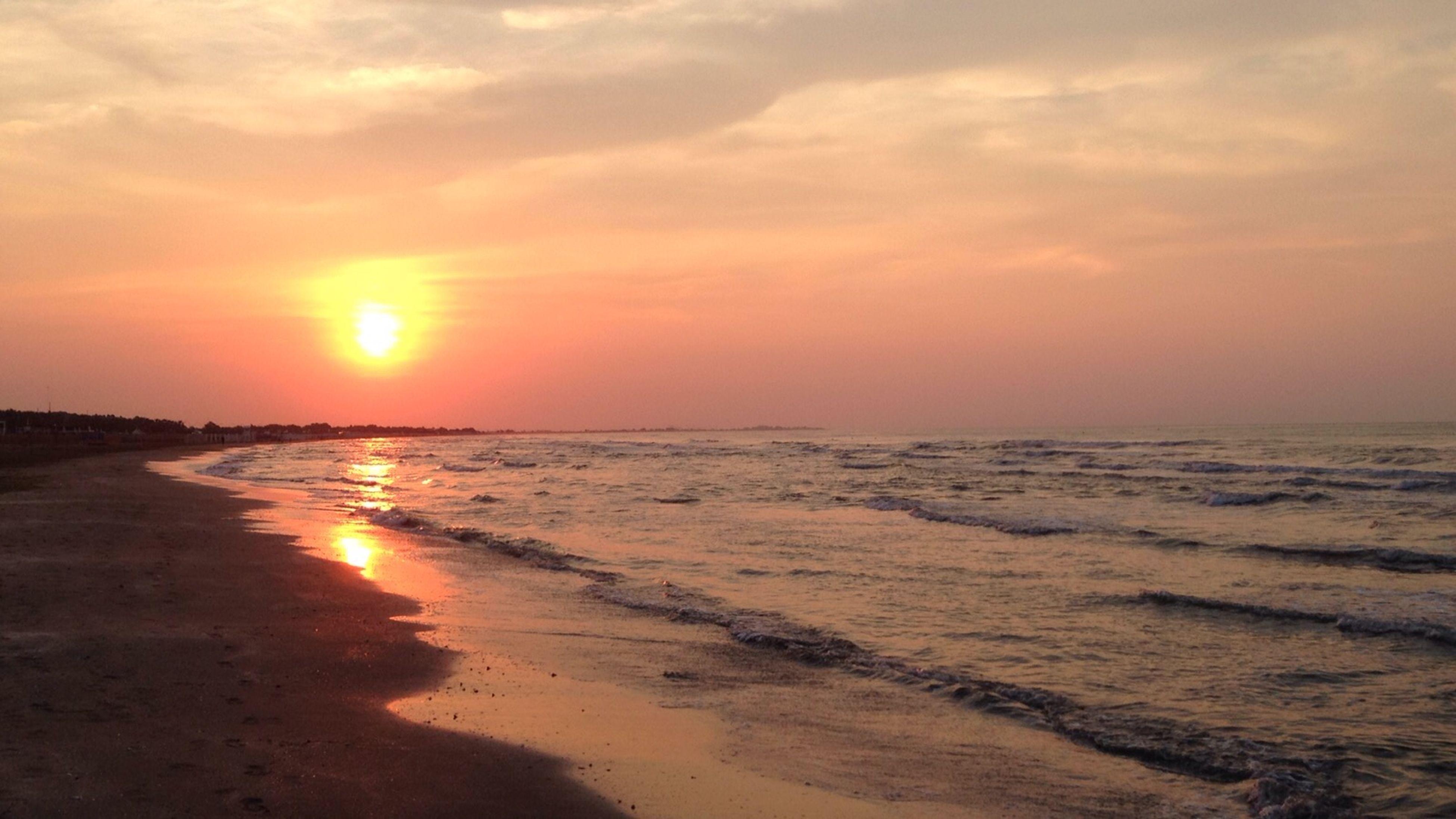sea, sunset, beach, horizon over water, water, scenics, shore, tranquil scene, beauty in nature, tranquility, sand, sky, orange color, sun, idyllic, nature, wave, reflection, coastline, cloud - sky