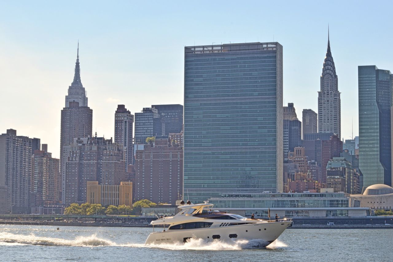 architecture, skyscraper, building exterior, built structure, city, tall - high, tower, modern, water, cityscape, nautical vessel, waterfront, urban skyline, downtown district, development, skyline, travel destinations, outdoors, day, financial district, tall, river, sky, no people, growth, nature