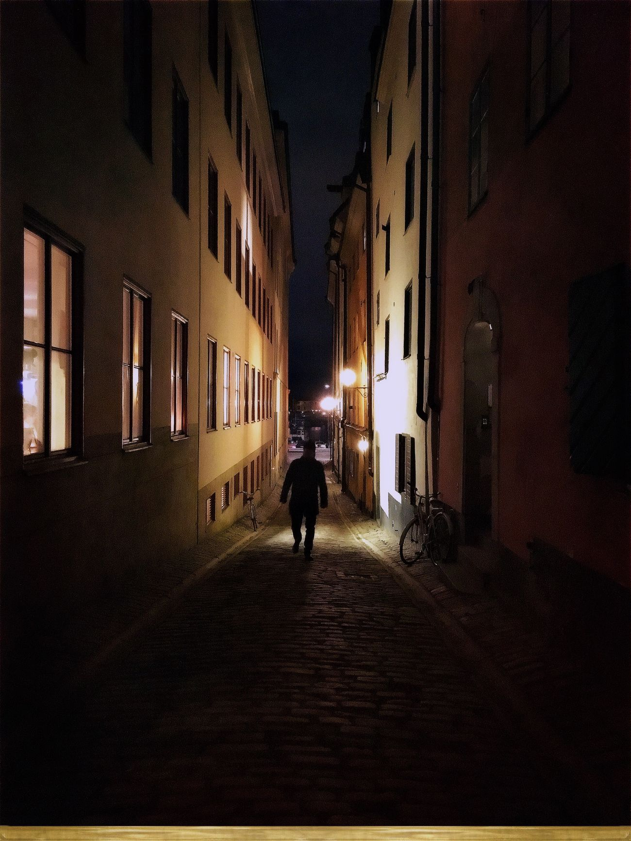 A Winter Night On The Streets Of Stockholm Architecture Walking My Own Style Of Beauty Man Shootermag Eyeem In Stockholm Outdoors Hipstography EyeEm Traveling ShotoniPhone6s Visual Witness Silhouette Night Night Lights Nightphotography Stockholm Light And Shadow Lines
