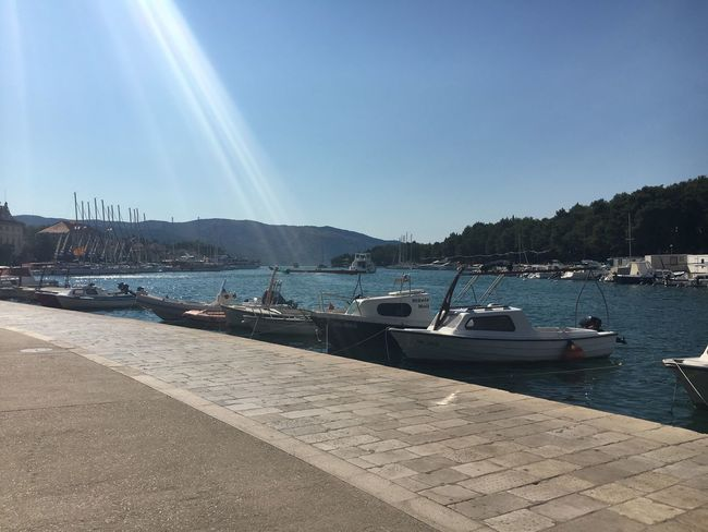 Boats on the water at Stari Grad, Croatia Boat Moored Sunbeam Mountain Water Clear Sky Tranquility Tranquil Scene Summer Chilled Relaxed Seaside Scene Adriatic Coast