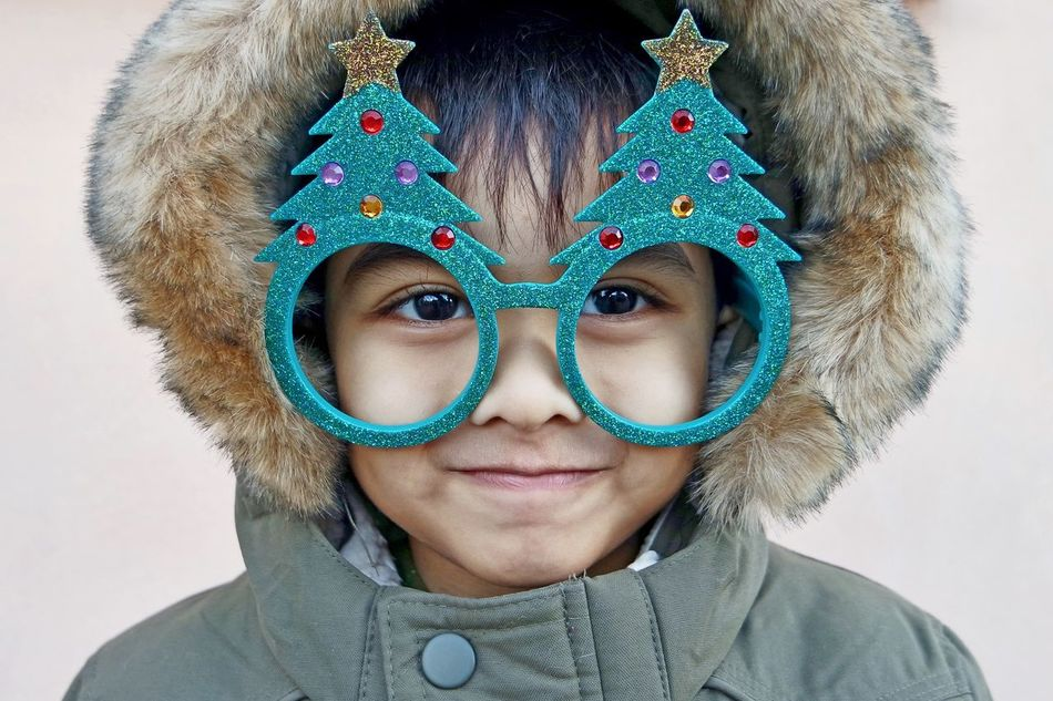 Christmas Looking At Camera Headshot Portrait Front View Studio Shot Real People One Person Close-up People Day Boy Christmas Tree