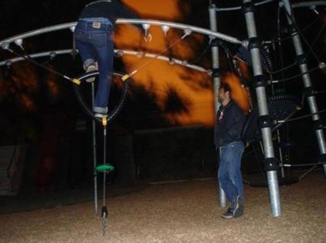 Climbing Hanging From The Monkey Bars Low Exposure Low Light Nighttime Orange Hue Outdoors Playground At Night Two People Unidentifiable People Adventure Club On The Way