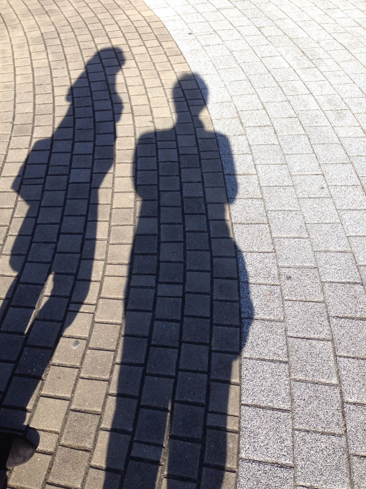 Couple Day Elevated View Focus On Shadow Footpath Ground Leisure Activity Lifestyles Outdoors Pavement Repetition Shadow Side By Side Sunlight Sunny Unrecognizable Person