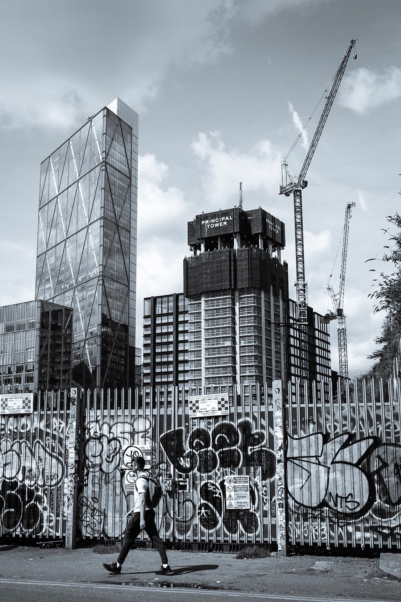 Architecture Built Structure Building Exterior Real People Cloud - Sky Sky City Day Outdoors Skyscraper Men Lifestyles Modern One Person Adult People Monochrome Blackandwhite Crane Construction London Railing Tree Graffiti