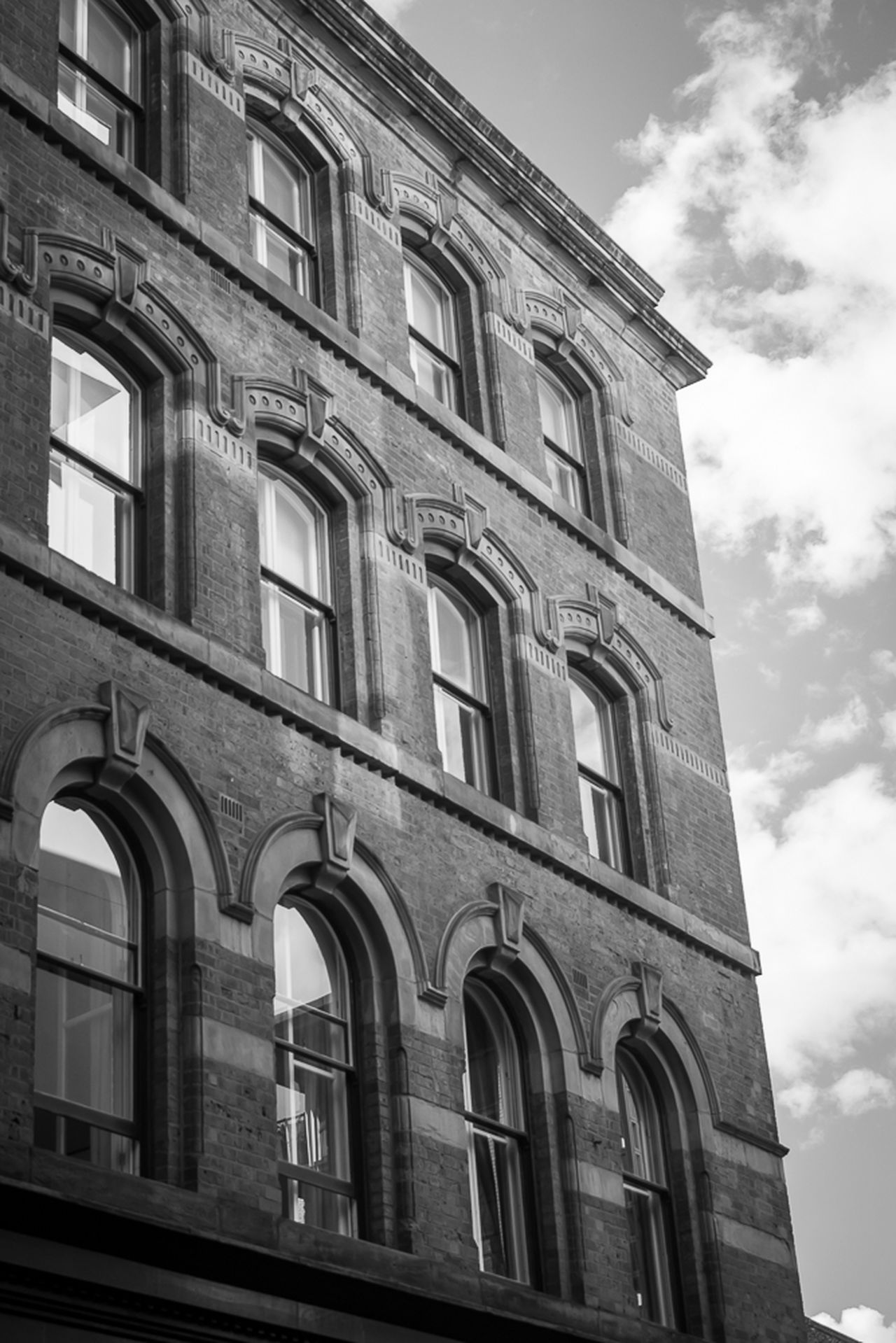 Architecture Built Structure Building Exterior History Travel Destinations Outdoors Sky No People City Balcony Day Streetphotographer Streetphotography_bw Blackandwhite Photography Streetphoto Black And White Blackandwhite Window City Architecture Low Angle View Lookingup