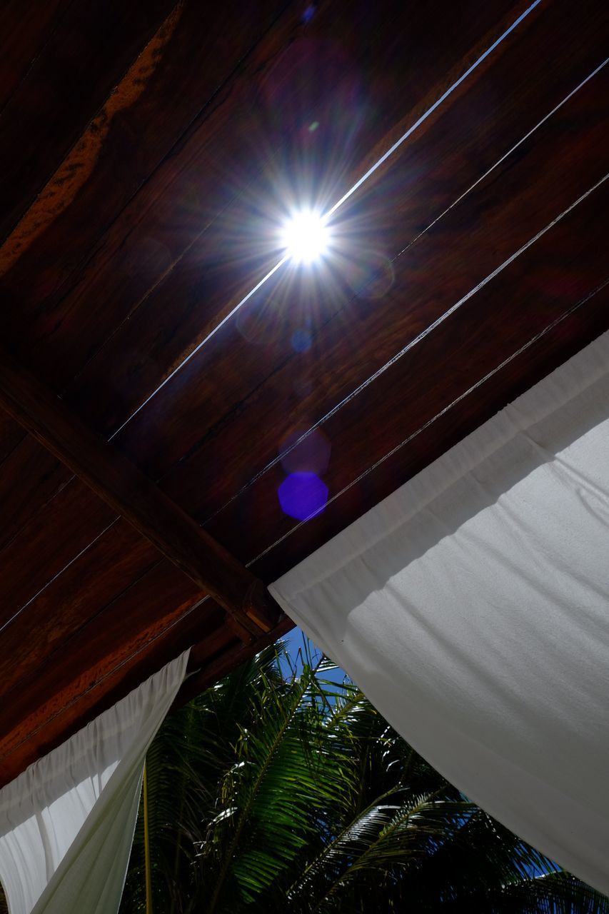 Sun Shining Through Crack In Roof