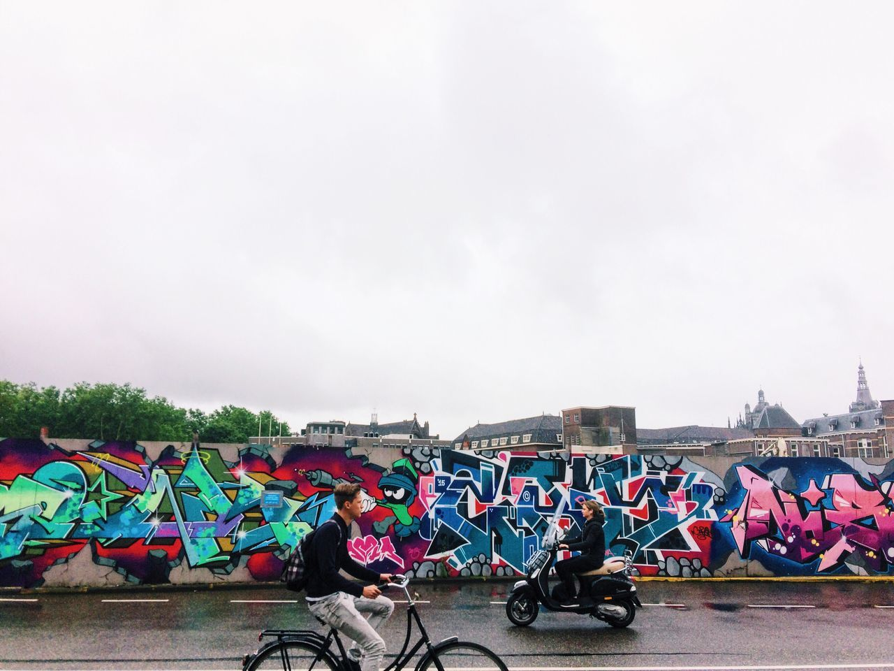 real people, day, mode of transport, outdoors, men, large group of people, transportation, sky, multi colored, people