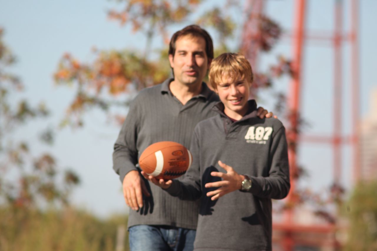 Dad Son football Two People Holding Looking At Camera Togetherness Portrait Focus On Foreground Outdoors Men Mature Adult Mature Men Bonding Autumn People American Football - Sport Day Young Adult Adult Adults Only Teamwork Nature