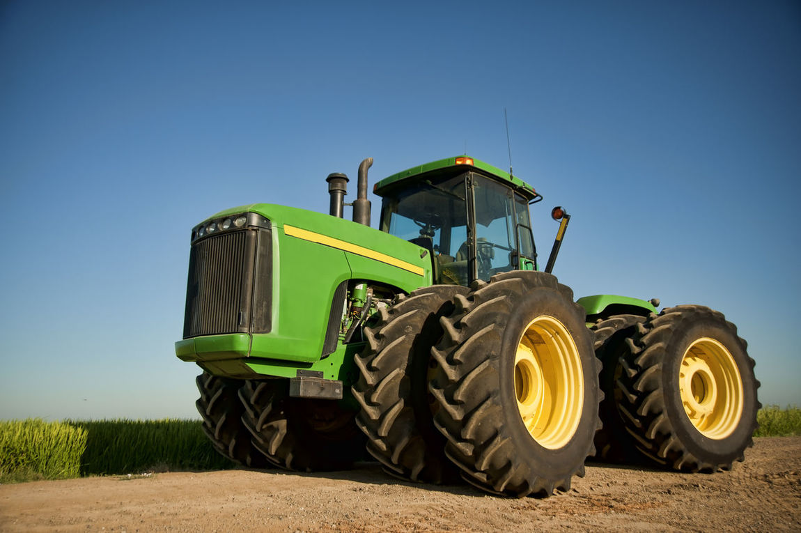 Farming tractor Agriculture Big Wheels Construction Vehicle Engine Equipment Eyelevel Farm Equipment Green Horizontal Composition Industry Large No People Outdoors Sky Tires Tractor Vehicle Window