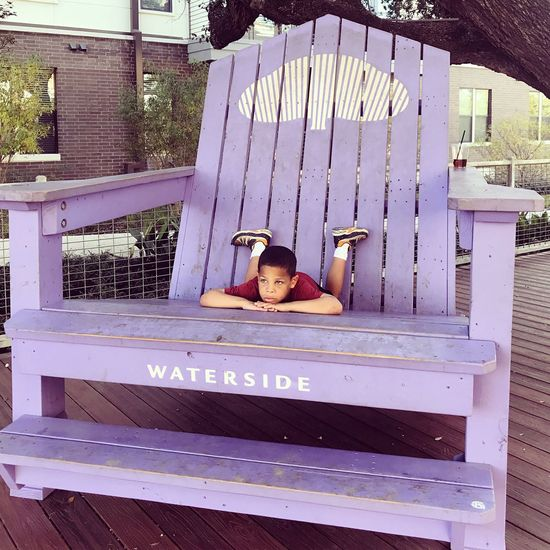 Leisure Activity One Person Wood - Material Relaxation Day Real People Outdoors People Childhood Giant Purple Chair Relaxing Thinking Serenity Young Boy