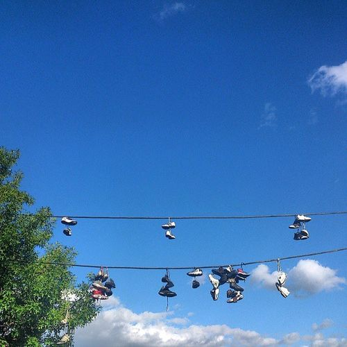 Shoetossing Shoefiti Shoes Hangingshoes Gangsign or Drugspot ? Astoria NYC maybe just Streetart