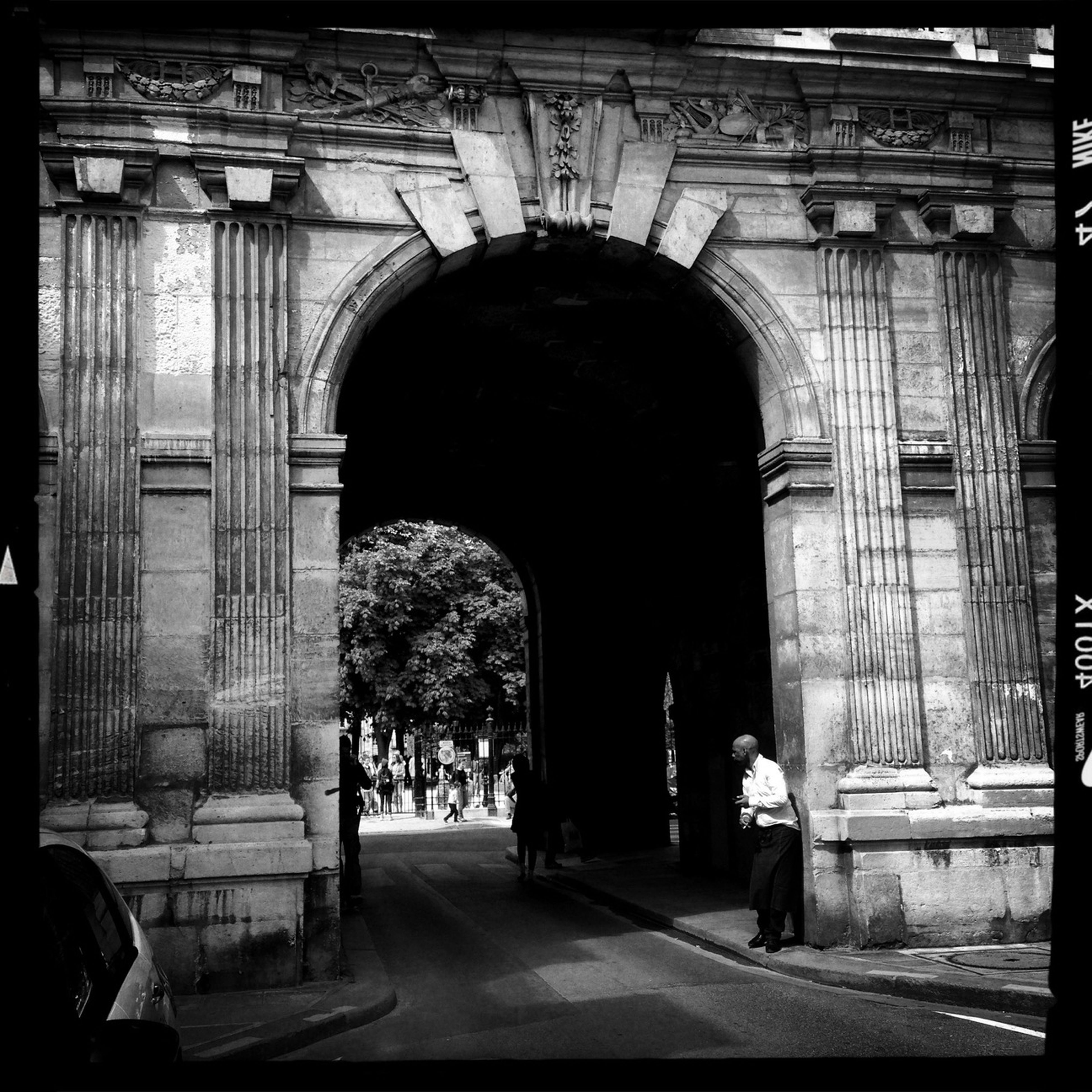 arch, architecture, built structure, building exterior, men, full length, walking, rear view, person, entrance, archway, lifestyles, gate, leisure activity, architectural column, day, the way forward