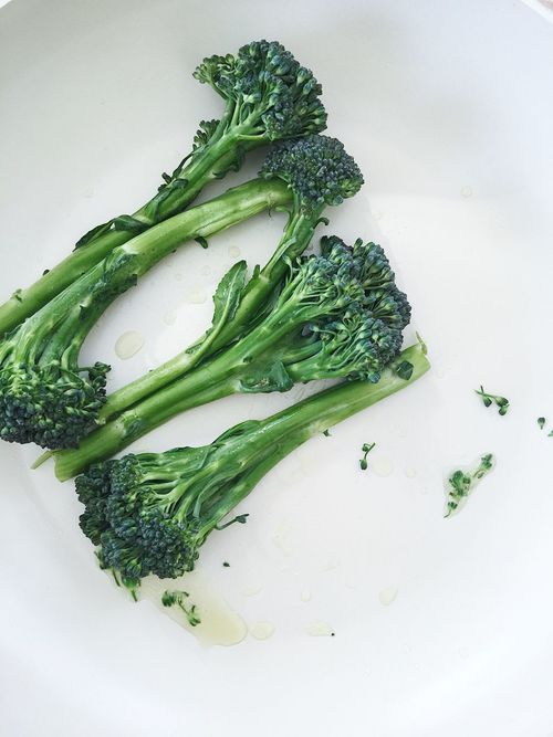 Broccoli sprouts being fried on a frying pan Broccoli Broccolisprouts Cooking Food Food And Drink Food And Drink Freshness Frying Pan Green Color Healthy Eating Vegetable White Background