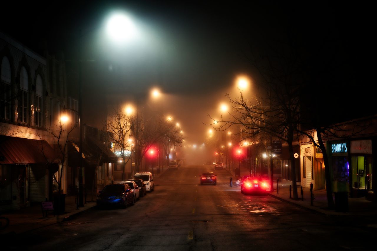 Architecture Building Exterior Built Structure Car City Fog Illuminated Land Vehicle Mode Of Transport Night No People Outdoors Road Sky Street Street Light Transportation Tree