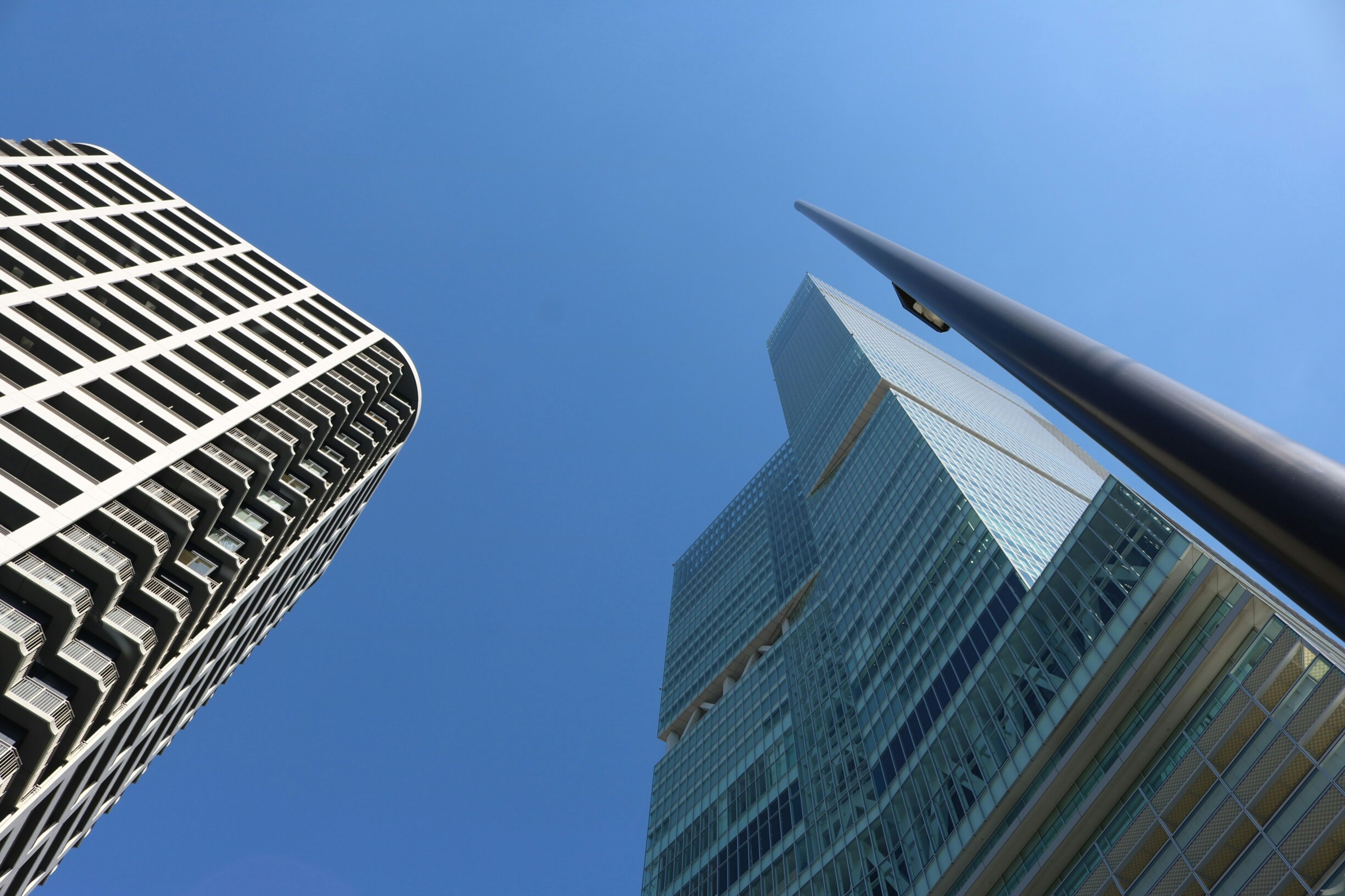 low angle view, architecture, building exterior, built structure, clear sky, tall - high, tower, skyscraper, modern, office building, city, blue, copy space, building, tall, directly below, day, glass - material, outdoors, no people