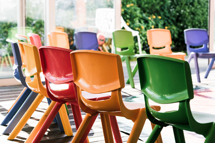 Waiting for the guests Children Kindergarten Nursery Nursery School Chair Children's Chair Close-up Colorful Day Green Color In A Row Indoors  Multi Colored No People Party Plastic Seat