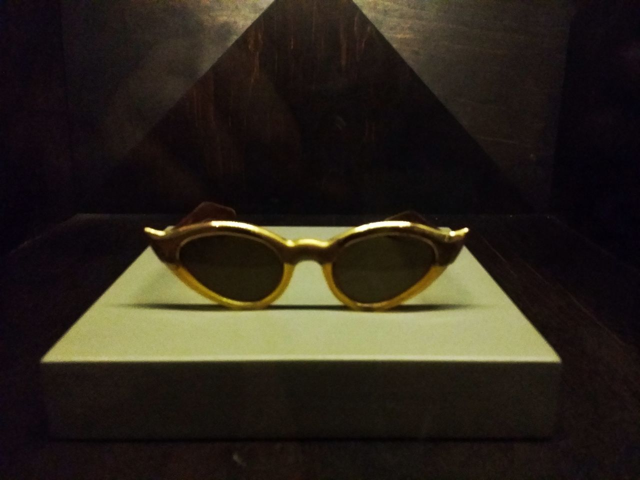sunglasses, gold colored, no people, indoors, gold, close-up, day