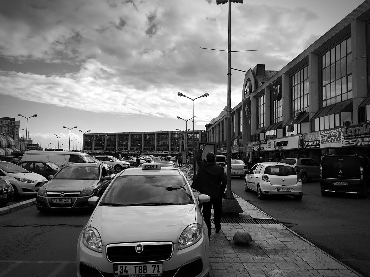 car, land vehicle, mode of transport, transportation, cloud - sky, sky, architecture, building exterior, built structure, city, street, road, outdoors, day, no people, cityscape