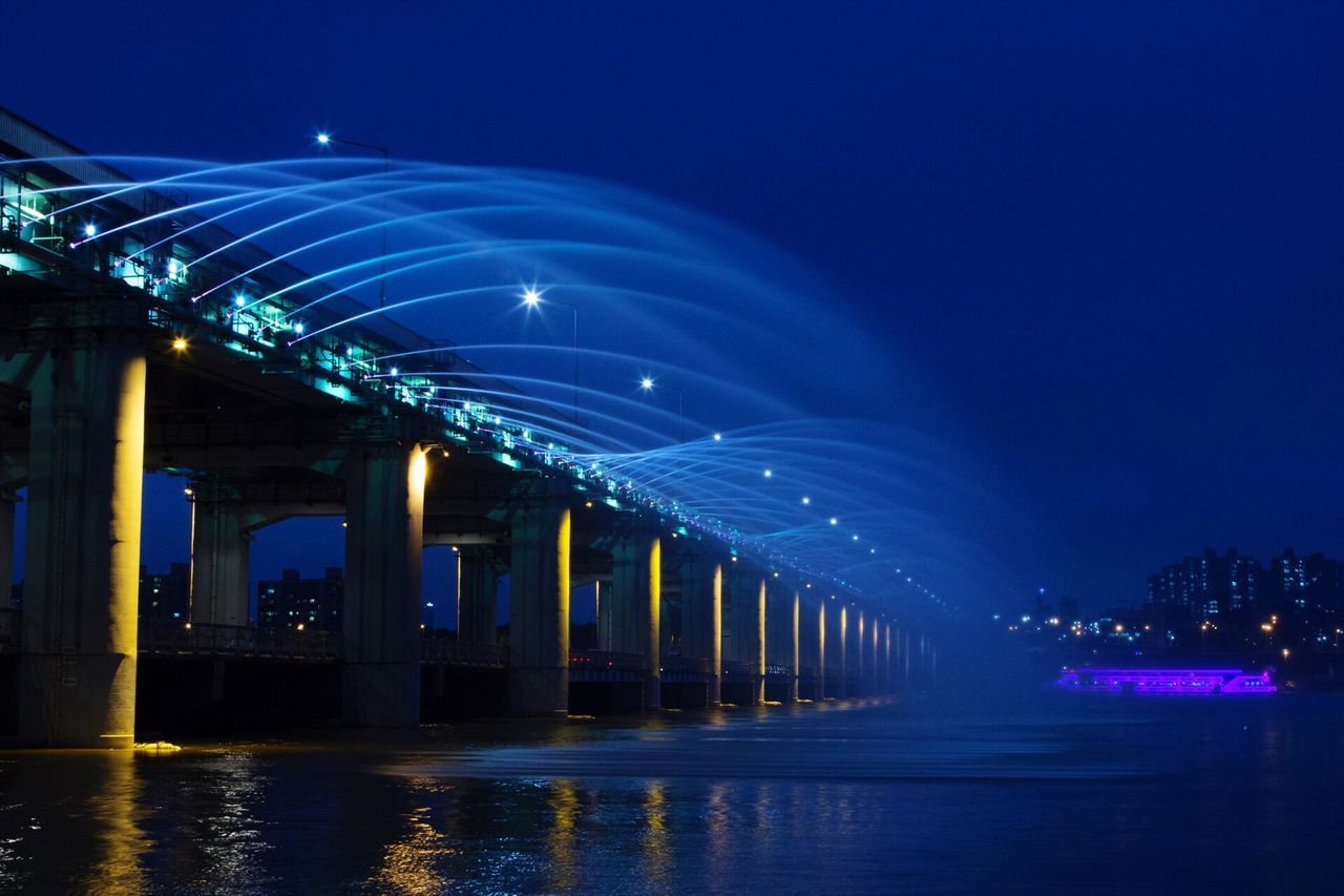 Illuminated Architecture Built Structure Lighting Equipment Blue Night Decoration Bridge - Man Made Structure Architectural Column Sky Electric Light Outdoors Engineering Famous Place Bridge Modern Surface Level City Life Multi Colored Banpo Bridge South Korea