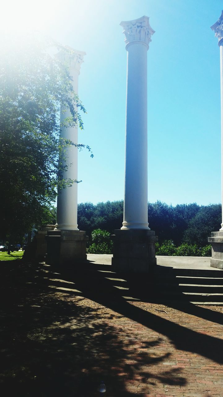 architectural column, built structure, architecture, monument, history, outdoors, no people, day, travel destinations, tree, sky